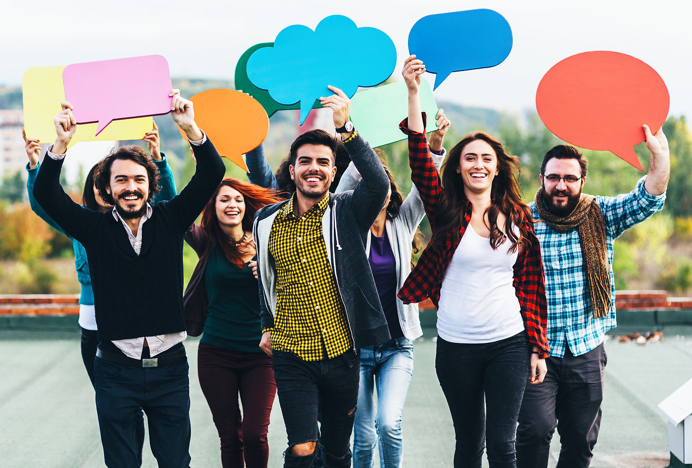 Happy people holding thought opinion bubbles