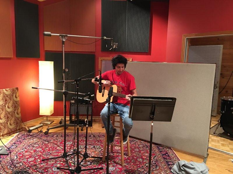 Josh Boria recording acoustic guitar at Virginia Arts Recording