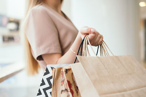woman-hand-holding-shopping-bags_t20_Xza1mR.jpg