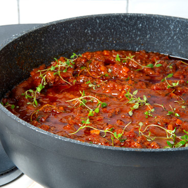 bolognese sauce with microleaves