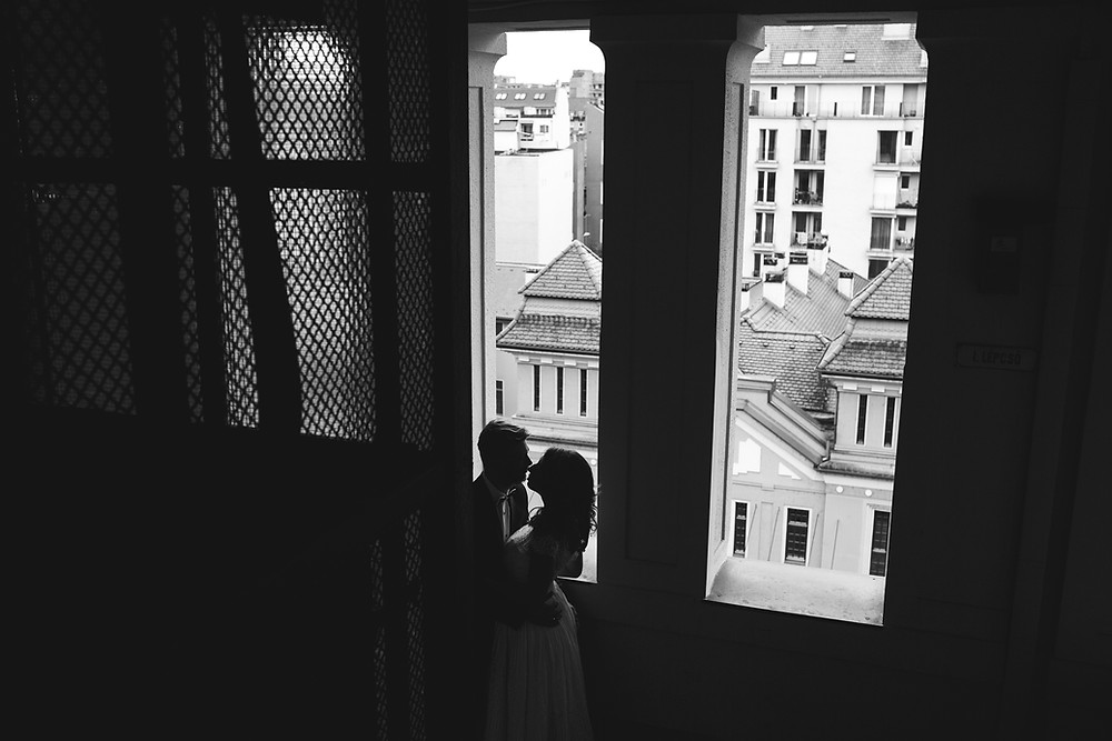 Silhouette of a couple eloping at the courthouse.