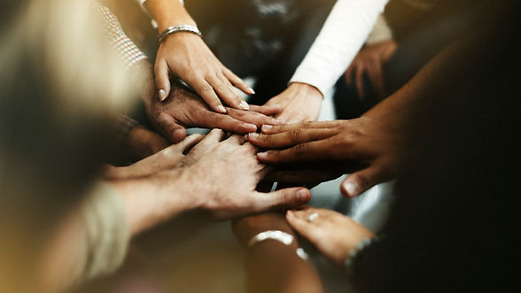 closeup-diverse-people-joining-their-han