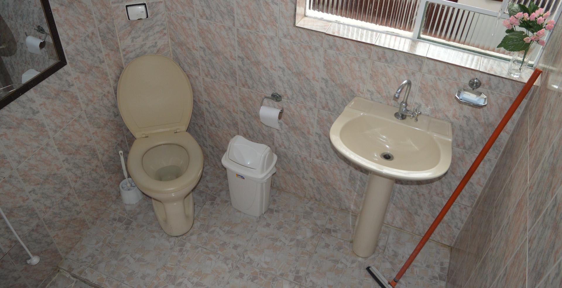Banheiro suite compartilhada superior