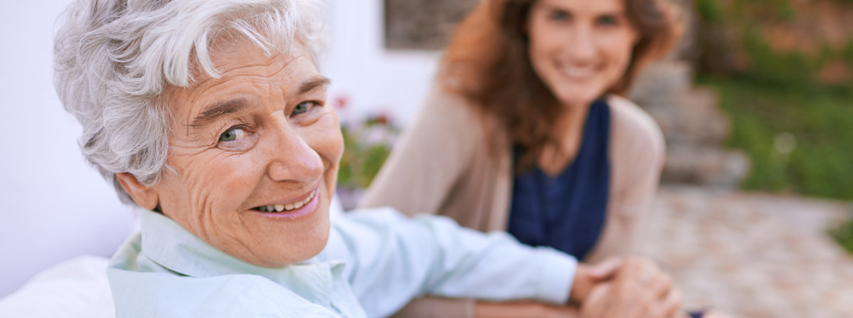 Senior woman visits with a home care aide