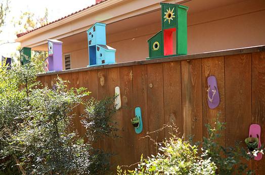 birdhouses on fence_small.jpg