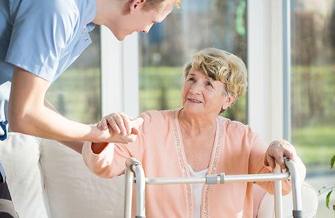 Male caregiver & senior lo res.jpg