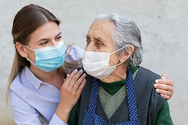 caregiver and senior with masks_lo res.j