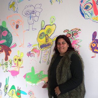 Mandy White with her mural Partying Dancing Creatures in the Kalyakool exhibition