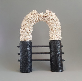 Helen Robins  barricaded  Earthenware paperclay, glaze metal