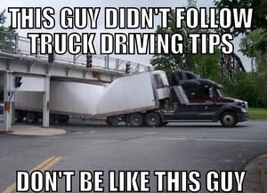truck stuck under a bridge