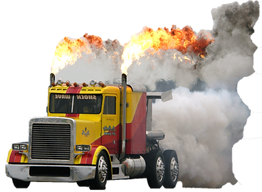 Red and yellow shockwave truck wth smoke