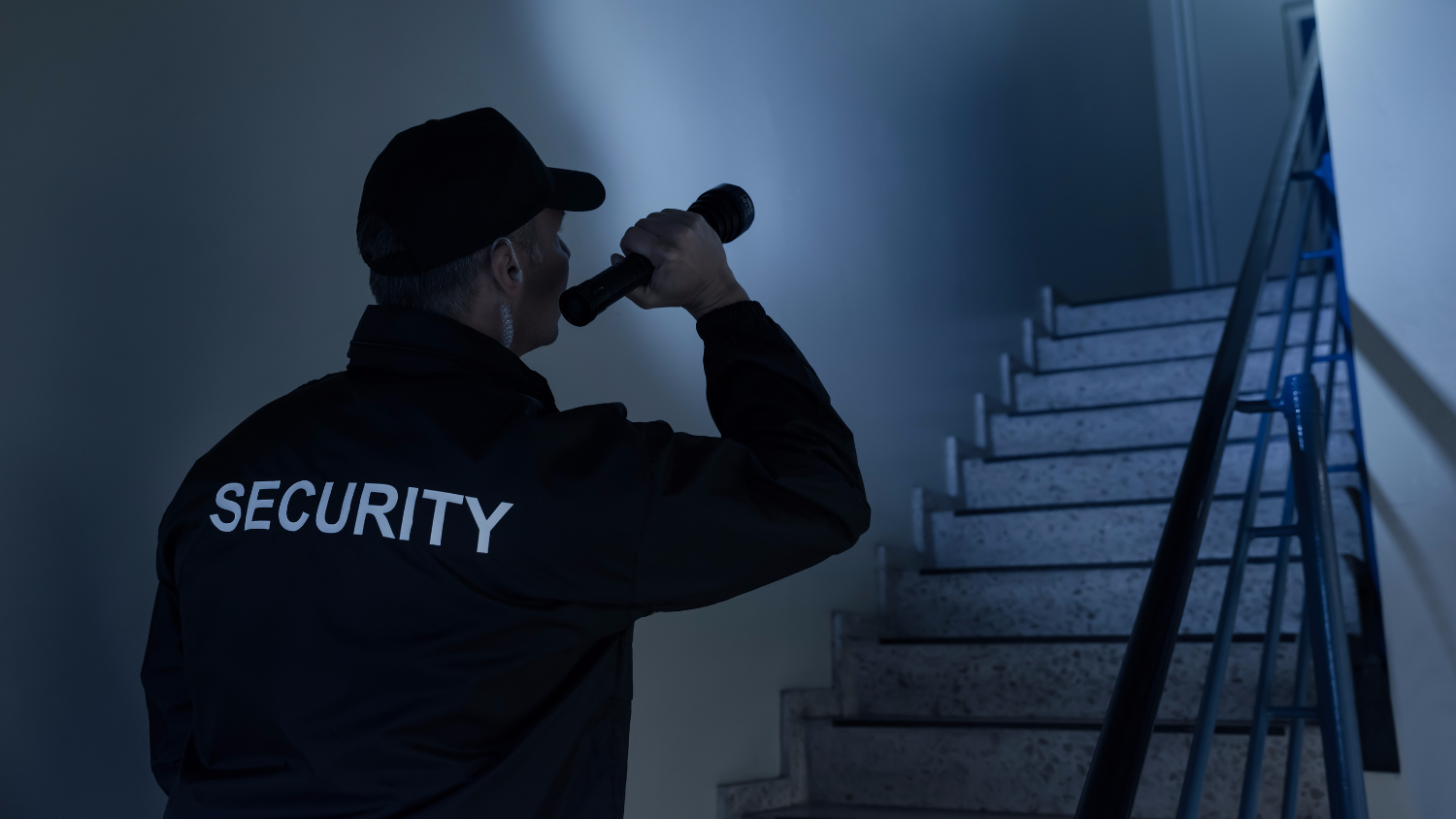 Security Guard Searching On Stairway With Flashlight_edited