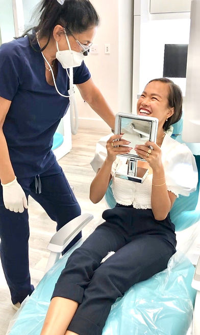 dentist with smiling patient