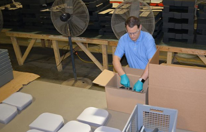 Nate Weaton, Creative Edge and Weaton Capital CEO, works on the assembly line producing medical face shields.