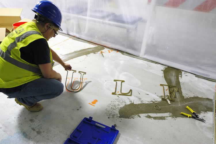 Terrazzo floor lettering installation