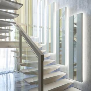 Обшивка лестницы искусственным камнем.