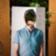 Tommy rectangular portrait in studio.jpg
