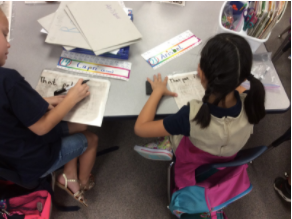 Student work collaboratively at Desert Mesa to build reading skills!