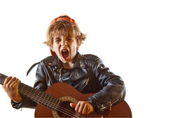 Cute small kid playing guitar with great
