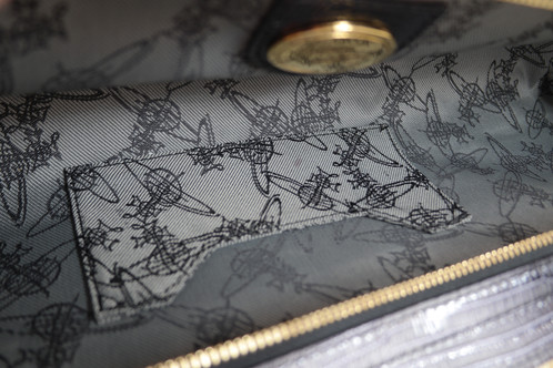 e2479c65d6 [USED] vivienne westwood long Clutch -come with dust bag only -scratches on  logo (see pic) -inner ->one small of stained.