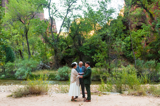 Elope Southern Utah - temple of sinawava elopement bride and groom exchange vows in beautiful zion national park