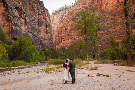 Elope Southern Utah - Temple of Sinawava wedding bride and groom look at each other surrouned by the beauty of Zion