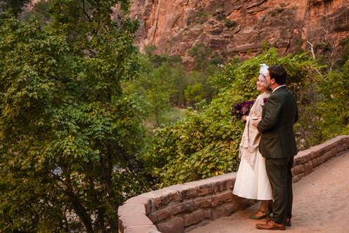 Elope Southern Utah - Temple of Sinawava wedding bride and groom look down the virgin river in zion national park