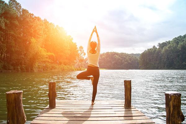 Woman on dock doing yoga