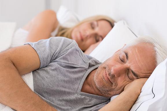 Couple sleeping restfully