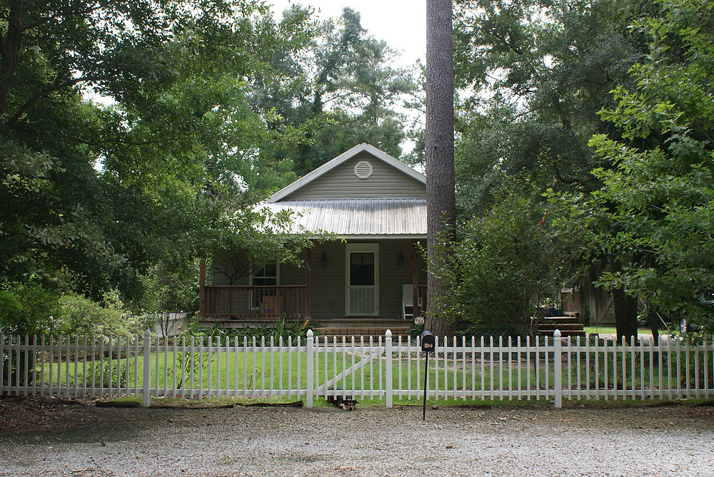 This is my cajun cottage in Louisiana and my dog Shelby.