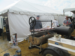 Cooking ribs at Hefty's field days