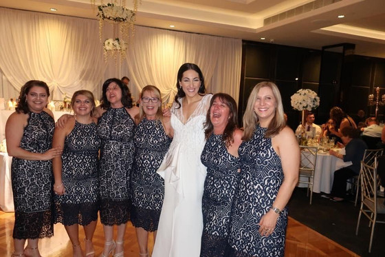 #14 Six wedding guests wore the same dress