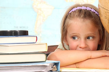 bigstock-Little-girl-with-books-26656088