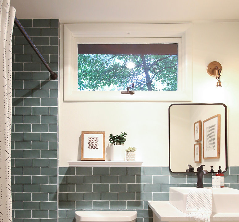 Kichler lighting in cute, small bath with green tile on HGTV Fixer to Fabulous