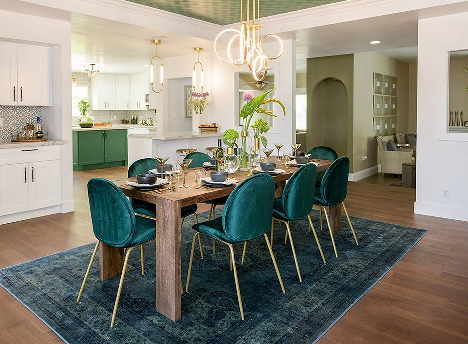 Gold light fixtures from Kichler lighting on Forever Home episode with green tile and chairs