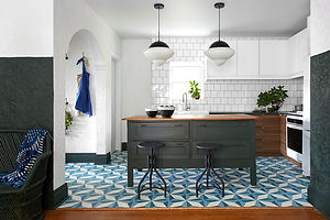 Home decor product placement of Geometric tile from Zia Tile in kitchen of Restored By The Fords with Leanne Ford