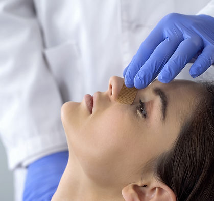 Doctor examining patient nose after rhin