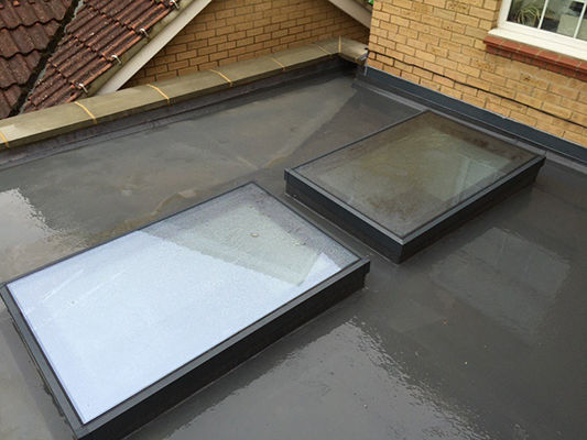 Flat rooflight with self-cleaning glass outside view