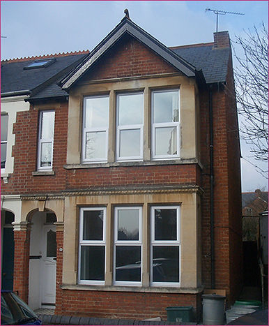 Victorian House with White Vertical Sliding Sash Windows
