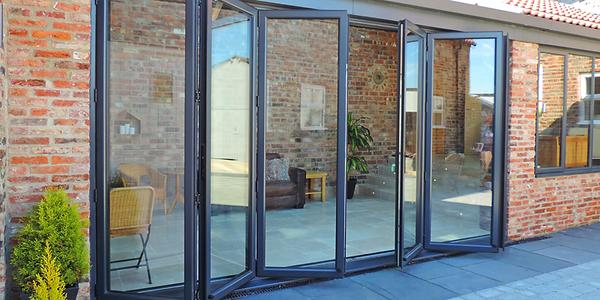 Bi-Fold Aluminium Doors in dark grey