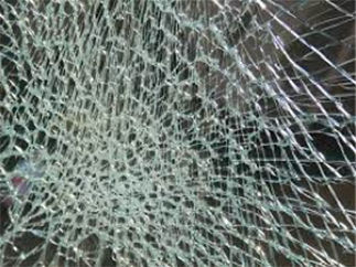 toughned glass breaks in to little peices when hit with a hammer