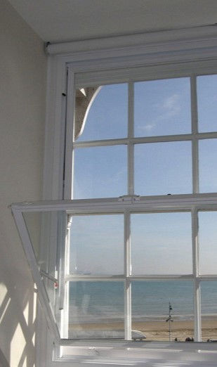 uPVC Window in White with Tilted Secondary Glazed bottom panel