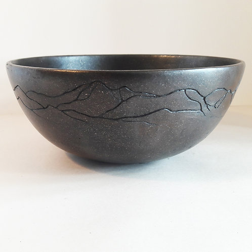 Black mica bowl with incised mountain design