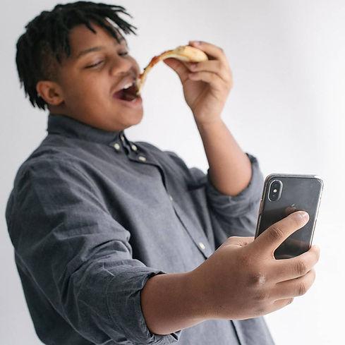 Teen eating pizza