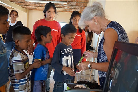 Darlene giving out toothbrushes (600 x 4