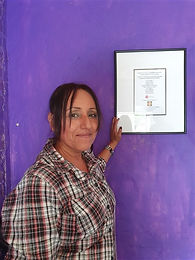 Anita with sign (450 x 600).jpg