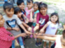 Children showing the bracelets they made