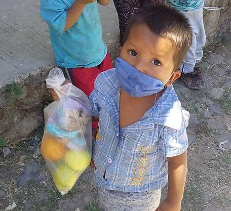 Boy getting fruit on May 25.jpg