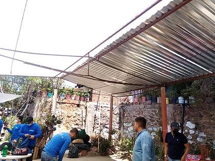 Team at work on the Brigada kitchen roof