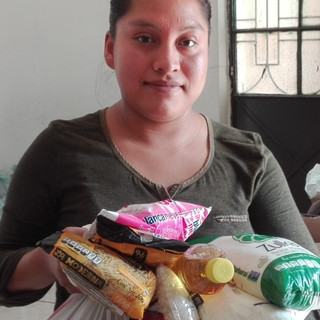 Receiving food and household items from